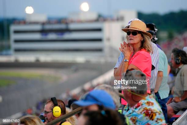 Fans look on during the NASCAR Camping World Truck Series Villa Lighting delivers the Eaton 200 presented by CK Power on June 23rd at Gateway...