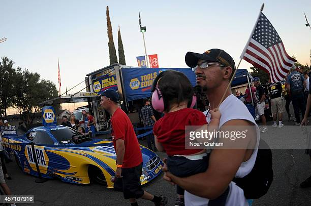 Fans look on during the NASCAR KN Toyota/NAPA Auto Parts 150 at the All American Speedway on October 11 2014 in Roseville California