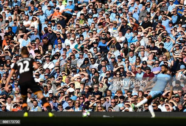 Fans look on during the Premier League match between Manchester City and Hull City at Etihad Stadium on April 8 2017 in Manchester England