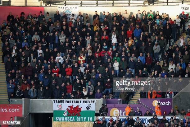 Fans look on during the Premier League match between Swansea City and AFC Bournemouth at Liberty Stadium on November 25 2017 in Swansea Wales