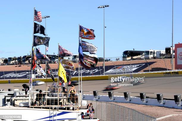 Fans look on during the start of the NASCAR Cup Series Pennzoil 400 presented by Jiffy Lube on February 23 at Las Vegas Motor Speedway in Las Vegas...