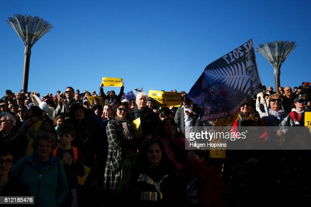 Fans look on during the Team New Zealand Americas Cup Wellington Welcome Home Parade on July 11 2017 in Wellington New Zealand