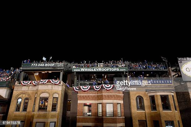 Fans look on from the rooftops across from Wrigley Field during Game Five of the 2016 World Series between the Chicago Cubs and the Cleveland Indians...