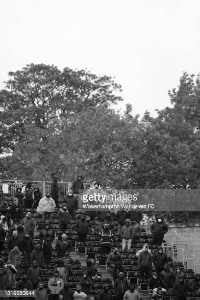 Fans look on from the stands during the Premier League match between Wolverhampton Wanderers and Manchester United at Molineux on May 23, 2021 in...