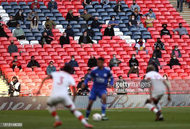 Fans look on from the stands during the Semi Final of the Emirates FA Cup between Leicester City and Southampton FC at Wembley Stadium on April 18,...