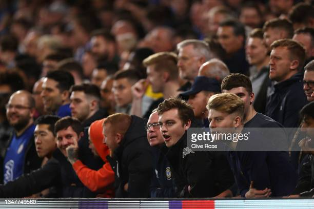 Fans look on from the stands during the UEFA Champions League group H match between Chelsea FC and Malmo FF at Stamford Bridge on October 20, 2021 in...