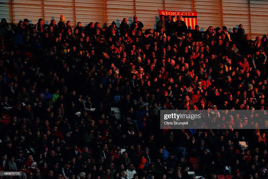 Fans look on in the winter sunshine during the Barclays Premier League match between Stoke City and West Bromwich Albion on December 28, 2014 in Stoke on Trent, England.
