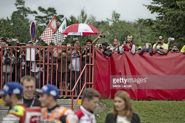 Fans look on on the podium at the end of the MotoGP race during the MotoGp of Czech Republic Race at Brno Circuit on August 21 2016 in Brno Czech...
