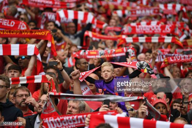 Fans look on showing support during the Premier League match between Liverpool FC and West Ham United at Anfield on August 12 2018 in Liverpool...