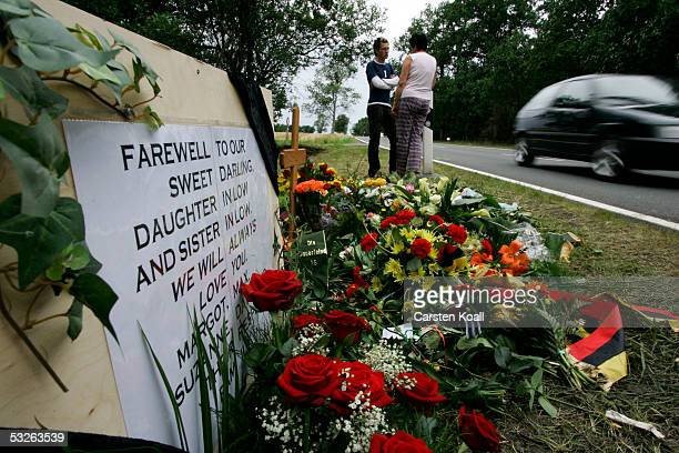 Fans look over a memorial for Australian cyclist Amy Gillett July 20 2005 in Zeulenroda eastern Germany Gillett was killed and five of her national...
