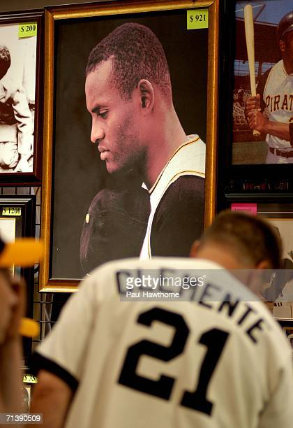 Fans look over Roberto Clemente memorabilia during opening day of Fan Fest for the Major League Baseball 2006 AllStar game at the David L Lawrence...