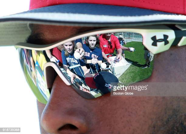 Fans looking for a postworkout autograph are reflected in the sunglasses of Red Sox outfielder Jackie Bradley Jr who stopped to oblige during spring...