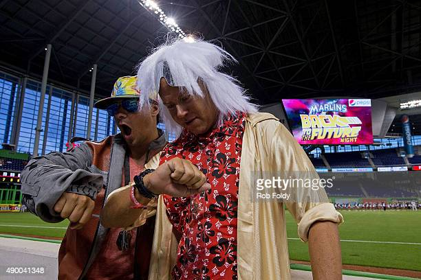 Fans Luis Carrera and Thomas Chase dressed as Marty McFly and Doc Emmett Brown from the movie ''Back to the Future'' pose for a photo before the game...