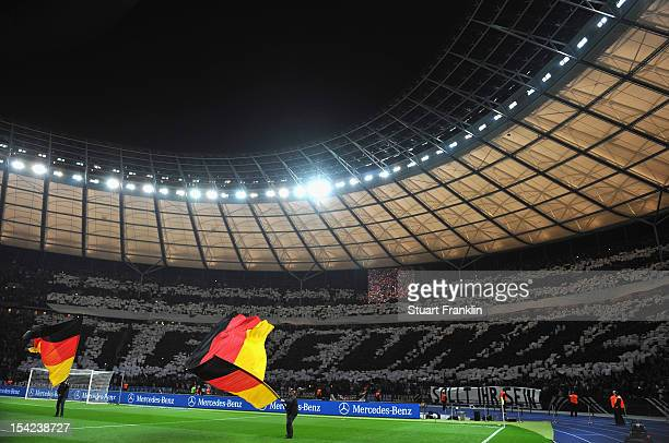 Fans make a mosaic at the Olympic stadium on October 16 2012 in Berlin Germany