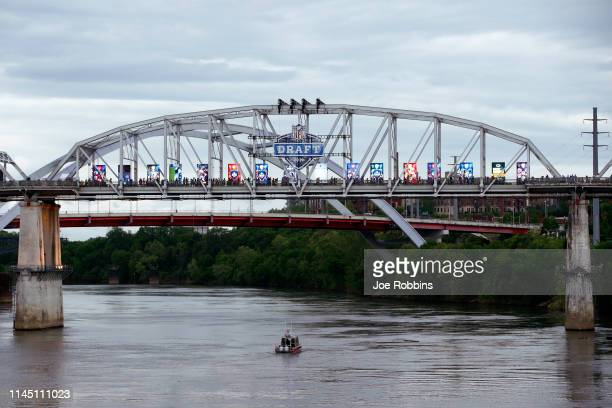 Fans make their way across a downtown bridge prior to the start of the first round of the NFL Draft on April 25 2019 in Nashville Tennessee
