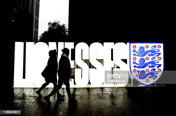 Fans make their way past a Lionesses sign ahead of the International Friendly between England Women and Germany Women at Wembley Stadium on November...