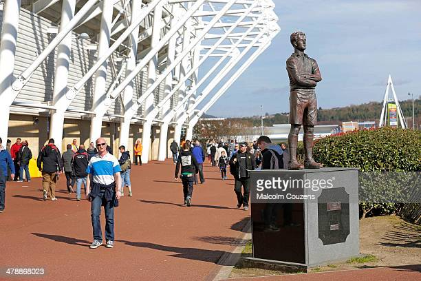 Fans make their way past a statue of Ivor Allchurch before the Barclays Premier League match between Swansea City and West Bromwich Albion at The...