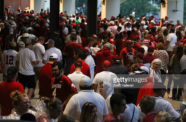 Fans make their way through the concourse during a rain delay prior to the game between Ohio State and Oklahoma at Gaylord Family Oklahoma Memorial...