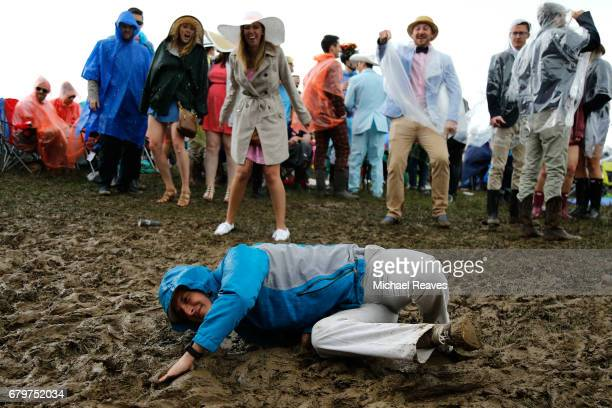 Fans make their way through the infield prior to the 143rd running of the Kentucky Derby at Churchill Downs on May 6 2017 in Louisville Kentucky