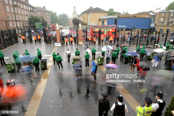 Fans make their way through the Jack Hobbs Gate into the Kia Oval on day four of the Fifth Ashes test