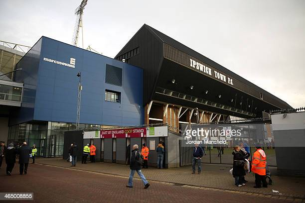 Fans make their way to the ground ahead of the Sky Bet Championship match between Ipswich Town and Reading at Portman Road on January 25 2014 in...