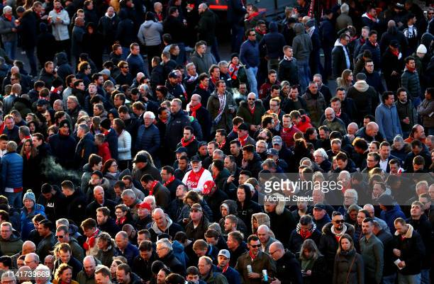 Fans make their way to the stadium ahead of the UEFA Champions League Quarter Final first leg match between Ajax and Juventus at Johan Cruyff Arena...