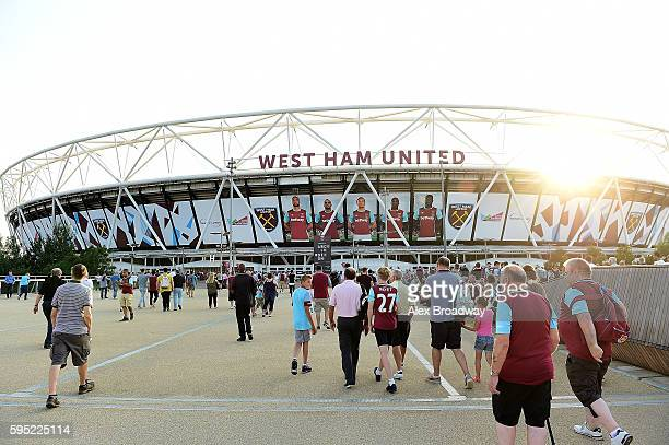Fans make their way to the stadium ahead of the UEFA Europa League match between West Ham United and FC Astra Giurgiu at the Olympic Stadium on...
