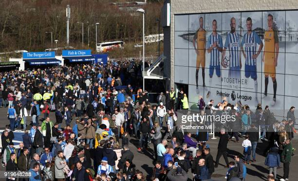 Fans make their way to the stadium before the Emirates FA Cup Fifth Round match between Brighton and Hove Albion and Coventry City at Amex Stadium on...