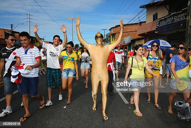 Fans make their way to the stadium prior to the 2014 FIFA World Cup Brazil Group G match between Germany and Ghana at Castelao on June 21 2014 in...