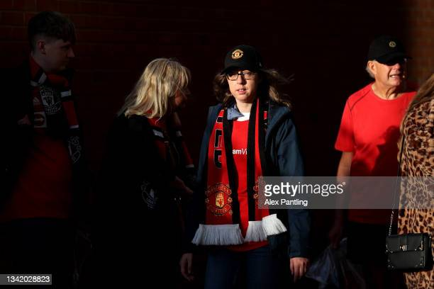 Fans make their way to the stadium prior to the Carabao Cup Third Round match between Manchester United and West Ham United at Old Trafford on...