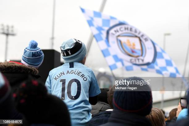 Fans make their way to the stadium prior to the FA Cup Fourth Round match between Manchester City and Burnley at Etihad Stadium on January 26 2019 in...