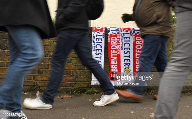 Fans make their way to the stadium prior to the FA Cup Fourth Round match between Brentford FC and Leicester City at Griffin Park on January 25 2020...