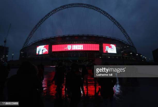 Fans make their way to the stadium prior to the International Friendly between England Women and Germany Women at Wembley Stadium on November 09,...