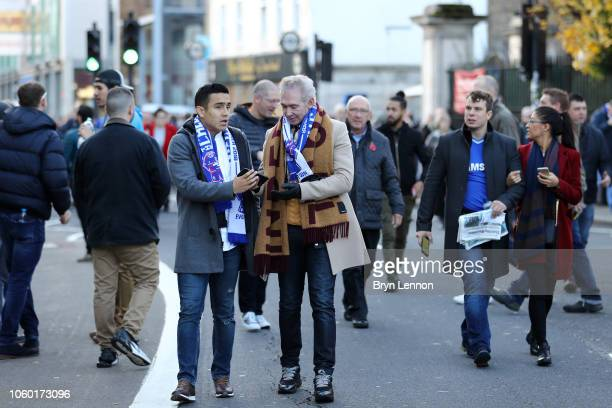 Fans make their way to the stadium prior to the Premier League match between Chelsea FC and Everton FC at Stamford Bridge on November 11 2018 in...