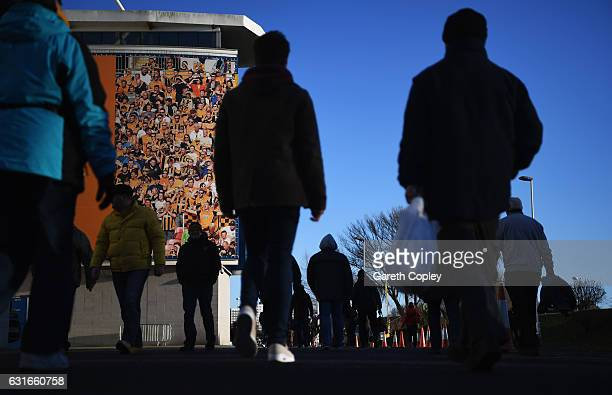 Fans make their way to the stadium prior to the Premier League match between Hull City and AFC Bournemouth at KCOM Stadium on January 14 2017 in Hull...