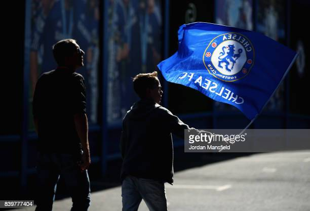 Fans make their way to the stadium prior to the Premier League match between Chelsea and Everton at Stamford Bridge on August 27 2017 in London...