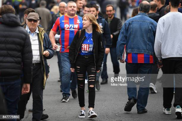 Fans make their way to the stadium prior to the Premier League match between Crystal Palace and Southampton at Selhurst Park on September 16 2017 in...