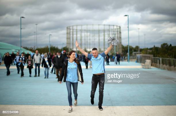 Fans make their way to the stadium prior to the Premier League match between Manchester City and Crystal Palace at Etihad Stadium on September 23...