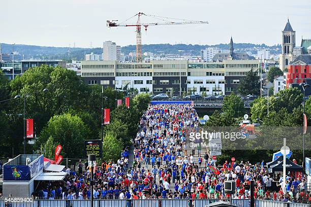 Fans make their way to the stadium prior to the UEFA EURO 2016 Final match between Portugal and France at Stade de France on July 10 2016 in Paris...