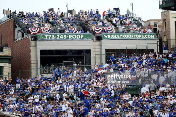 Fans make their way to their seats before game three of the National League Division Series between the Washington Nationals and the Chicago Cubs at...