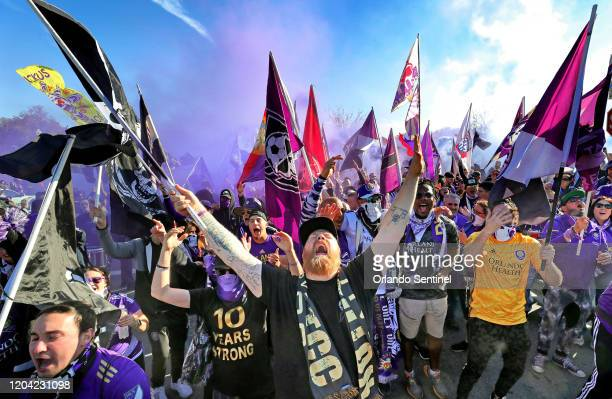 Fans march together into Exploria Stadium ahead of Orlando City's season opener against Real Salt Lake in Orlando Fla on Saturday February 29 2020