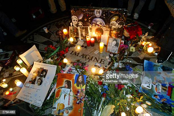 Fans mark the anniversary of musician John Lennon's death with a makeshift memorial at Strawberry Fields in Central Park December 8 2003 in New York...