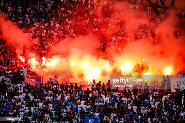 Fans Marseille with lightfire during the Ligue 1 Uber Eats match between Marseille and Rennes at Orange Velodrome on September 19, 2021 in Marseille,...