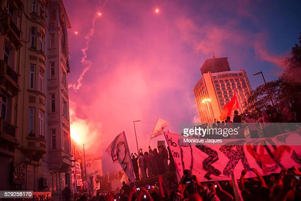 Fans merge in Taksim square, lighting flares and fireworks. Hundreds of thousands of football fans from the three major Istanbul teams march on...