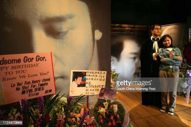 Fans Michelle Liaw from Malaysia posts photographs with Leslie Cheung's wax figure at Madame Tassauds Fans lay wreaths to Leslie Cheung's wax figure...