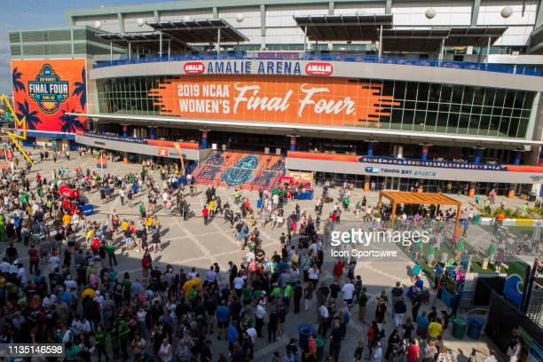 Fans mingle in Tournament Town before the 2019 NCAA Women's Division I Championship Final Four game between the Oregon Ducks and the Baylor Bears on...