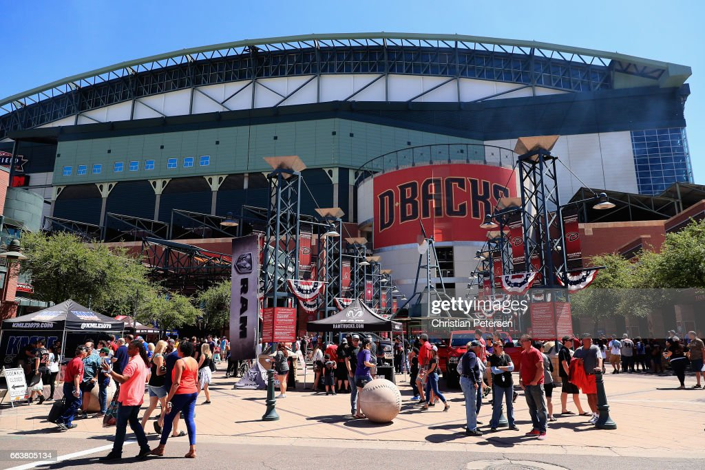 Fans mingle outside of Chase Field before the MLB opening day game between the San Francisco Giants and the Arizona Diamondbacks on April 2, 2017 in Phoenix, Arizona.