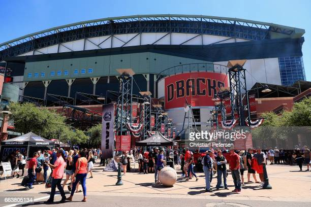 Fans mingle outside of Chase Field before the MLB opening day game between the San Francisco Giants and the Arizona Diamondbacks on April 2 2017 in...