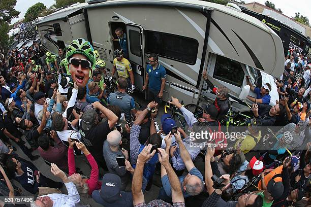 Fans mob the Tinkoff team bus as Peter Sagan of Slovakia riding for Tinkoff emerges in the overall race leader's jersey prior to the start of stage...