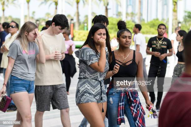 Fans mourn after exiting the XXXTentacion Funeral Fan Memorial at BBT Center on June 27 2018 in Sunrise Florida
